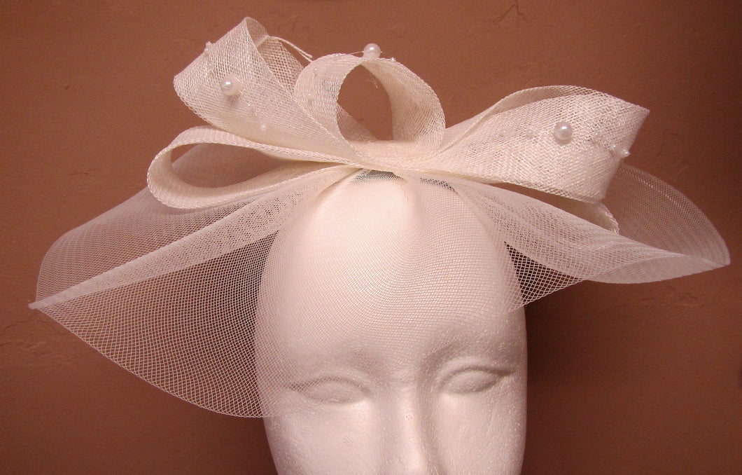 Handcrafted white bridal hair bow piece with pearls on a headband