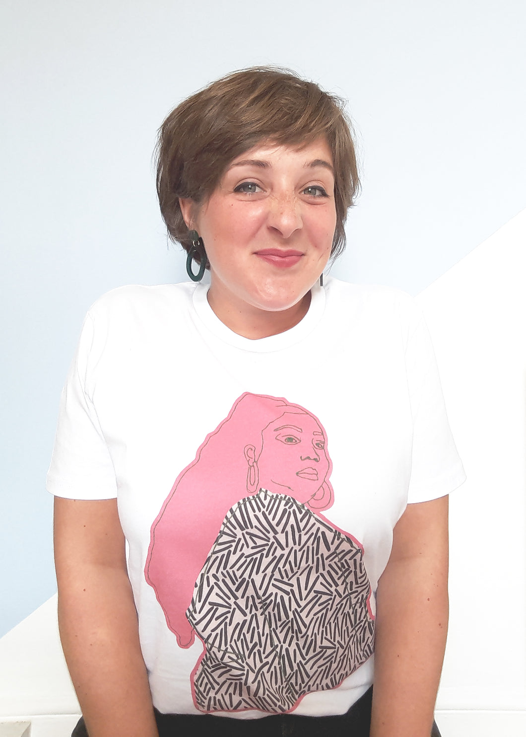 girl pulling cute face wearing white tee with pink Lizzo artwork on by Loaf and Bear