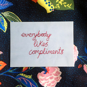 'EVERYBODY LIKES COMPLIMENTS' A6 POSTCARD