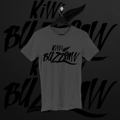 Travis Banks: Kiwi Buzzsaw Charcoal Tee - Pins & Knuckles Wrestling Merch United Kingdom
