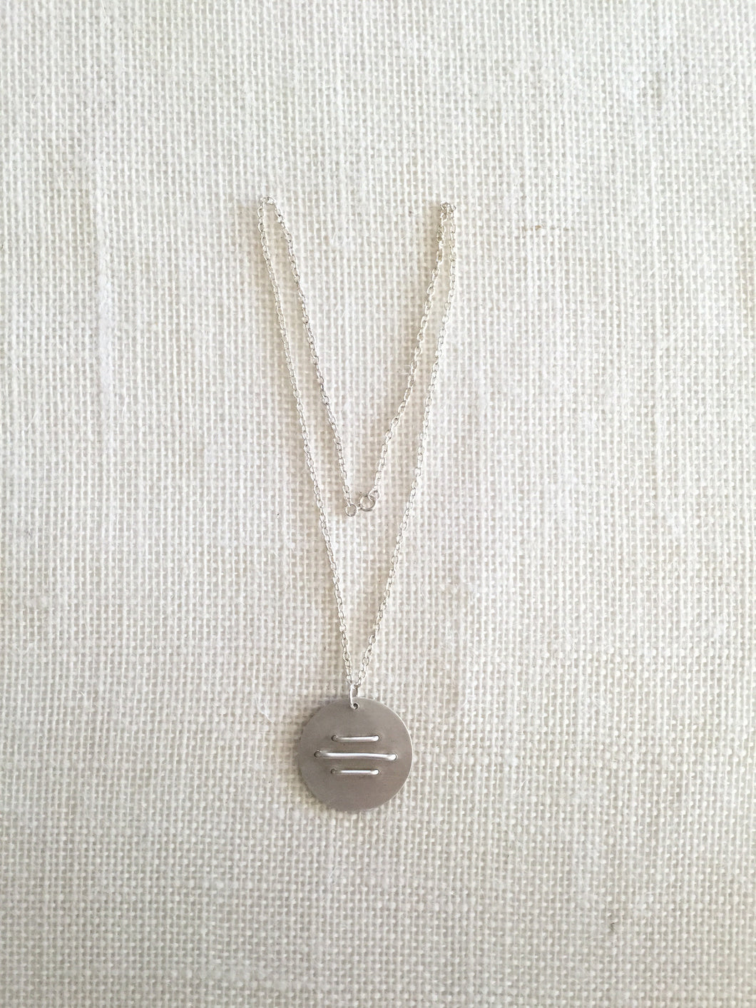 Stitched Disc Pendant