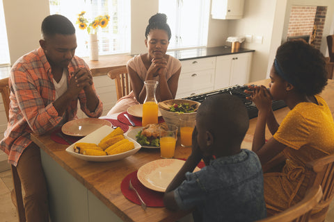 Family praying for food together