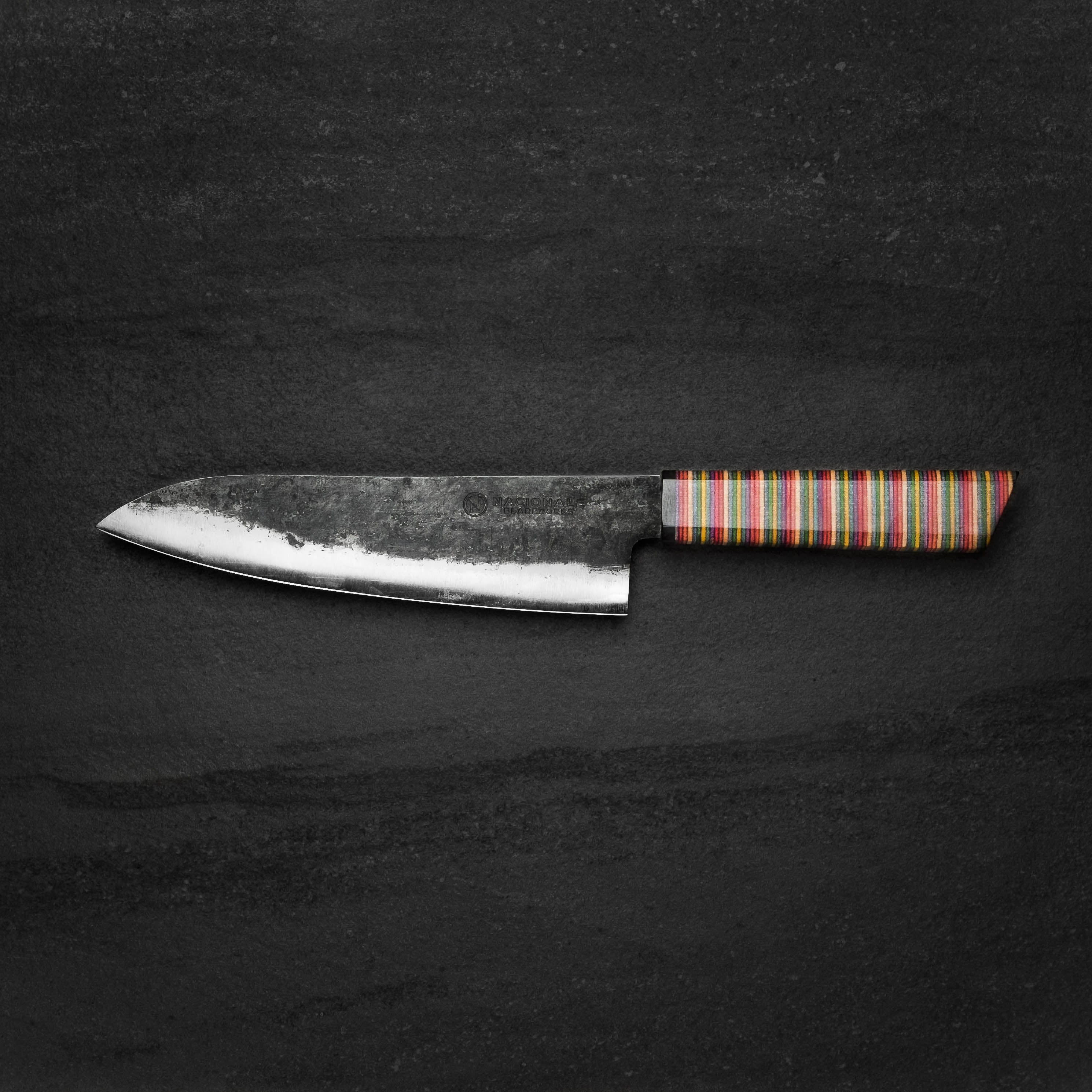 180mm Kurouchi Santoku with Skateboard Handle and Ox Horn Ferrule made by Nacionale Bladeworks.