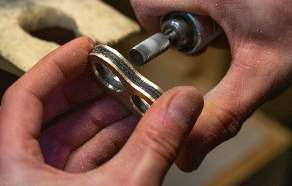 Grinding the finger holes to create a rounded, comfort fit