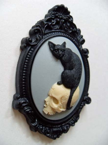 BLACK CAT ON SKULL CAMEO BROOCH