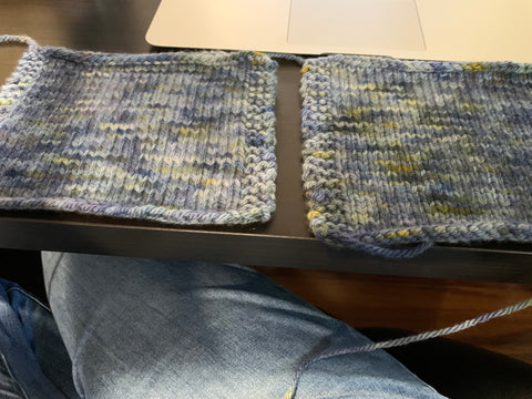 Two swatches of knitted fabric, side by side on a table.