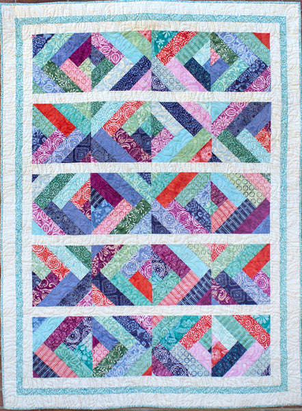 Crosscut - a blue quilt with braids made using batiks