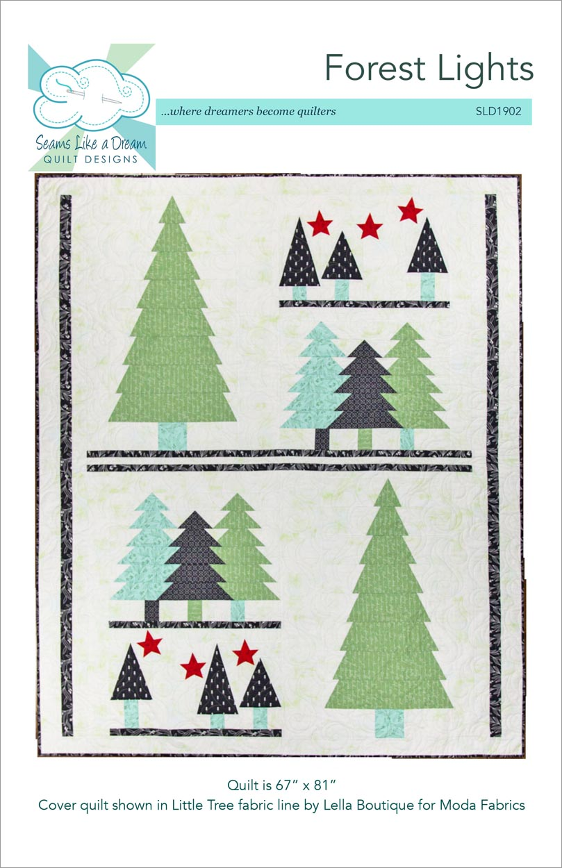 Forest lights- a modern holiday tree quilt in green, aqua and black fabrics.