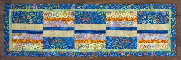 Split Strip- easy to piece runner in batiks