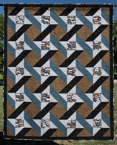 Urban Twist lap quilt in brown, black and blue fabrics with mustache fabric