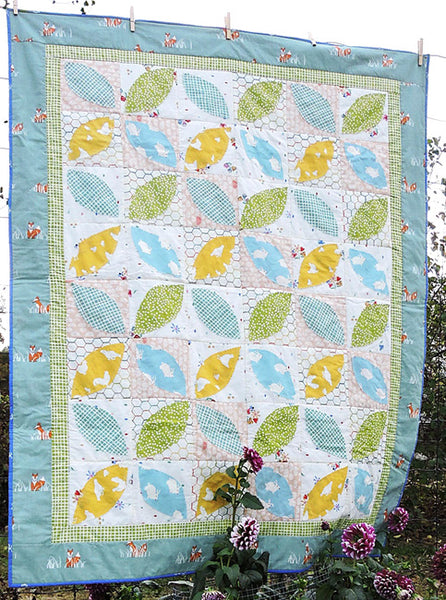 Little Leaves- a fun pieced and machine appliquéd baby quilt pattern in organic fabrics