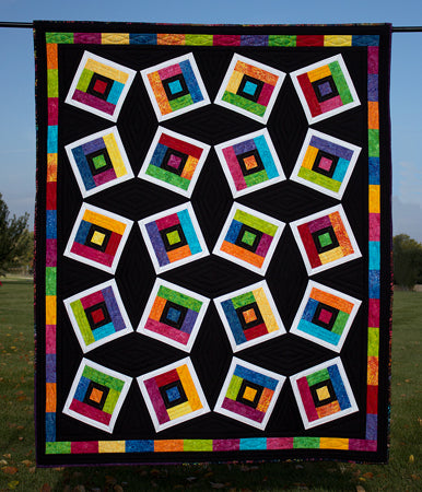 Magnetic Midnight a strip quilt pattern in batiks and black and white