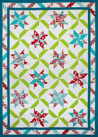 Ribbon Candy - a fat quarter friendly lap quilt in reds, blues and green