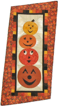 Stack O'jacks- pumpkin quilt pattern with appliqué pumpkin faces