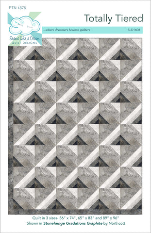 Totally tiered- a quilt pattern using shades of one color to create the design