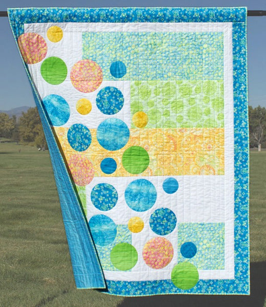 Bubbles- an easy to piece quilt with machine appliquéd circles in blues and greens