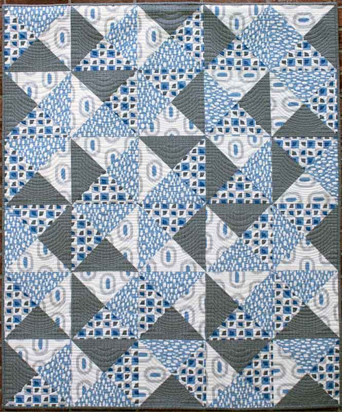 Quarter Turn crib quilt in blue and grey