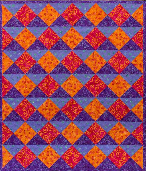 Quarter Turn - lap quilt in orange and purple batiks