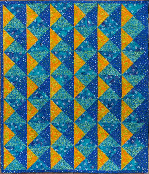 Quarter Turn lap quilt in blue and yellow batiks