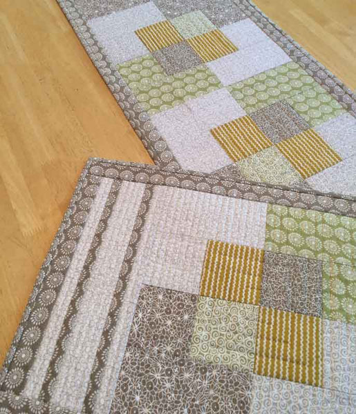 Stroll - a quilted placemat and table runner pattern in tan and gold fabrics from Urban Scandinavian fabric line by Kirstyn Cogan