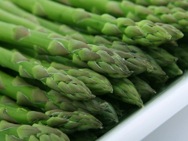 Green asparagus on table