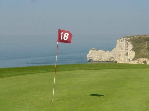 Golf green with number 18 flag located on cliffs by the sea