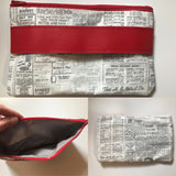Fully Lined Vintage Look Newsprint Clutch