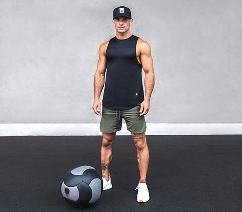 Man Wearing Born Tough Tank and Shorts