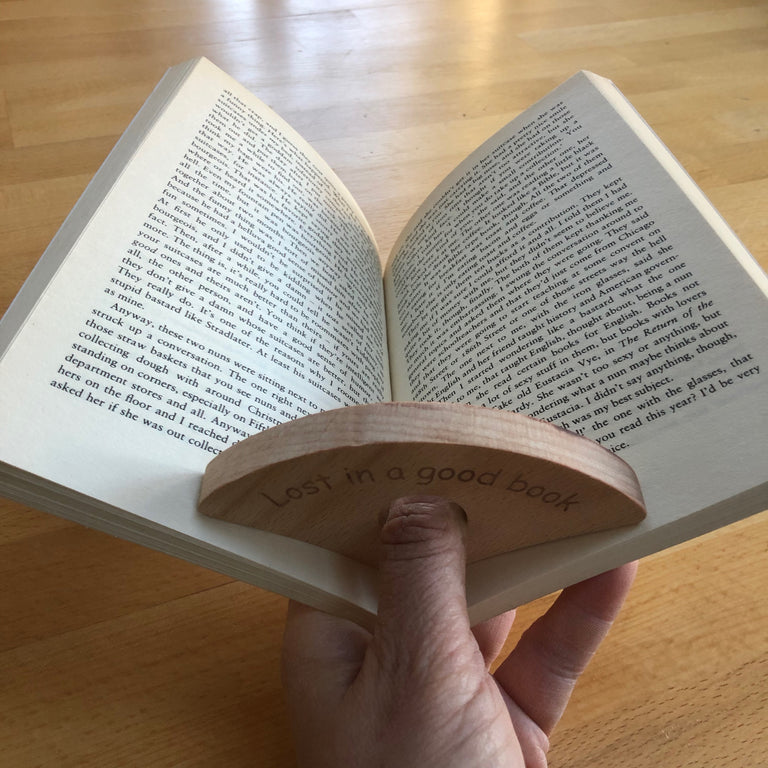 Wooden thumb book holder - plot twist