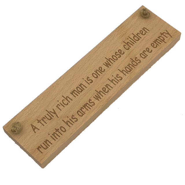 Wooden hanging plaque - a truly rich man