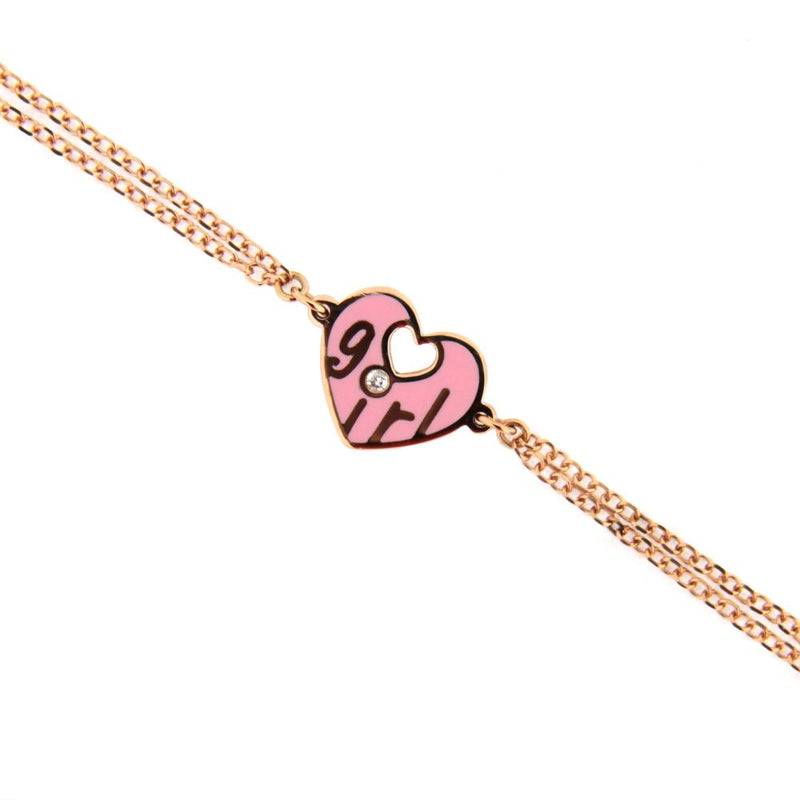 18K Pink Gold Diamond Pink Ceramic Heart Bracelet with the word GIRL in Gold and the Diamond on top of the i. 7 inches with extra rings staring at 5.75 inchesAmalia J. & Boutique Bracelets
