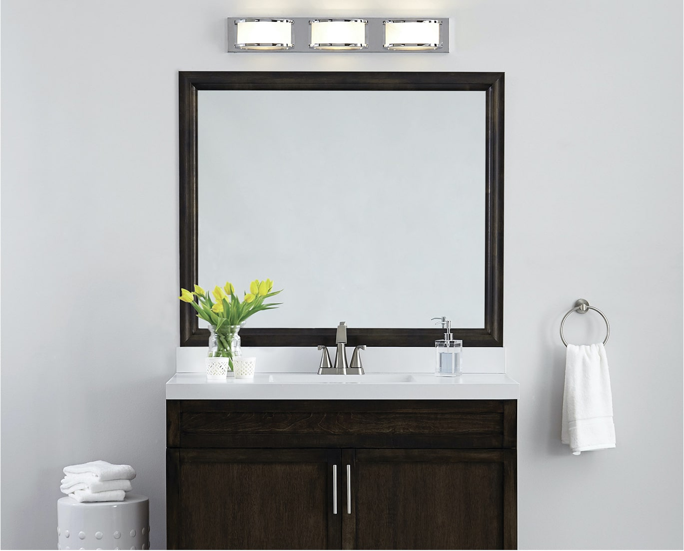Chelsea Espresso mirror frame situated above the vanity.