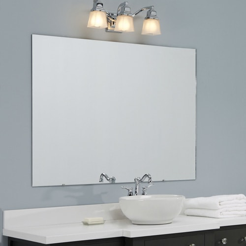 Plain, plate glass wall mounted mirror in a bathroom with blue walls and a wood vanity with white counter.