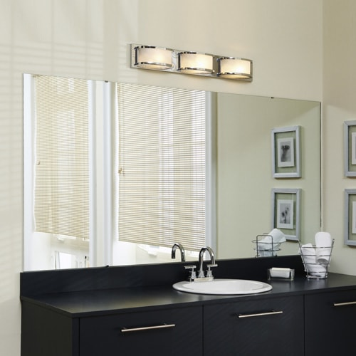 Modern bathroom with black vanity, light walls, silver contemporary lighting and a plate glass vanity mirror.