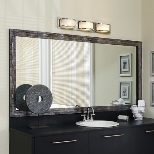 Contemporary batrhoom with black vanity, light walls, silver lighting and a subway-tile inspired mirror frame in blue and black tones.