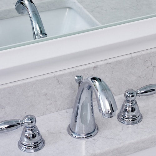 Bright white bath with MirrorMate frame in the Chelsea Classic White on the mirror.