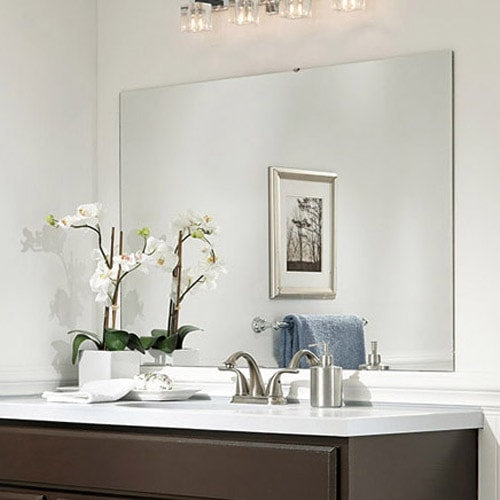 Bathroom featuring a brown painted cabinet, white walls and counter and blue hand towel.