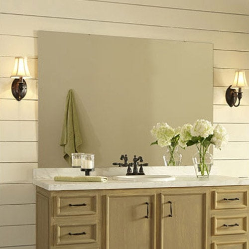 Pretty, neutral bathroom featuring white shiplap walls, light wood vanity and oiled bronze hardware.