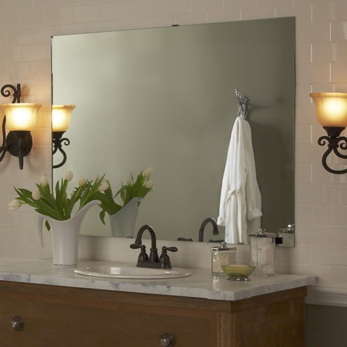 Transitional style bathroom features white subway tile wall, marble counter, wood vanity and oiled bronze hardware.