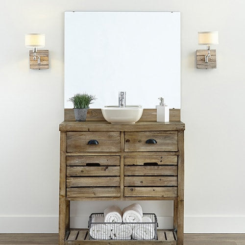 Bathroom vanity and unframed mirror.