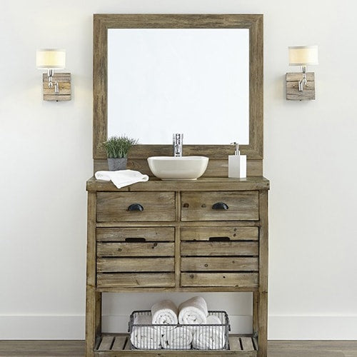 Barnwood style mirror frame on the mirror along side a rustic bathroom vanity.