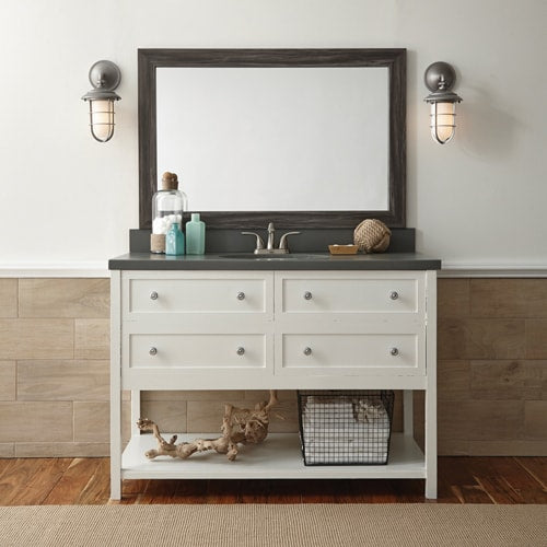 This coastal style bathroom features a white vanity on a white wall, a grey counter and a complimenting grey mirror frame in the Cherokee Montauk Driftwood.