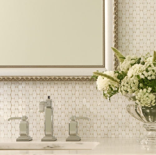Close up of bathroom mirror framed in the ornate Bellemeade Vintage Silver frame style.