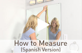 Preview of the spanish version of the how to measure video showing girl preparing to measure her plate glasss wall mirror with a tape measure.