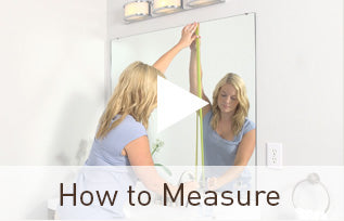 Preview of the how to measure video showing girl preparing to measure her plate glasss wall mirror.
