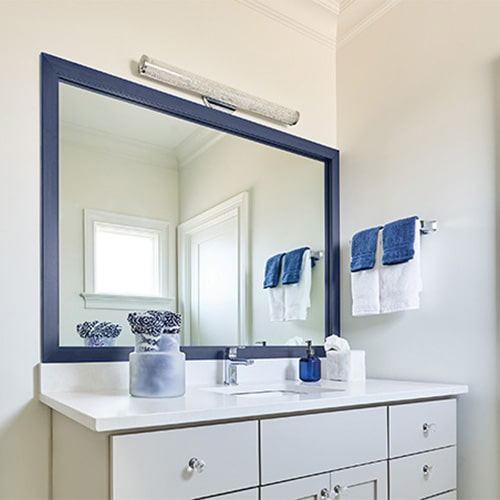 Ocean Deep Blue Sea mirror frame situated above the vanity.