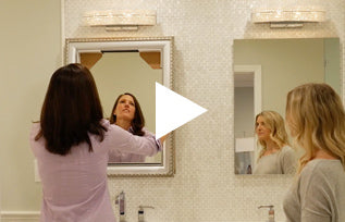 Play button for video showing installation of frame on mirror that does not rest on backsplash.