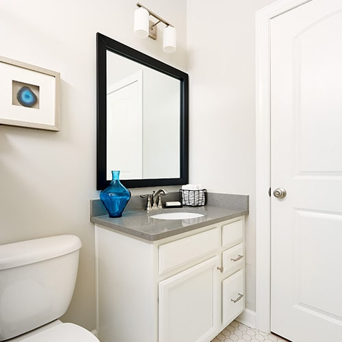 Highline Slim Midnight Black mirror frame situated above the vanity.