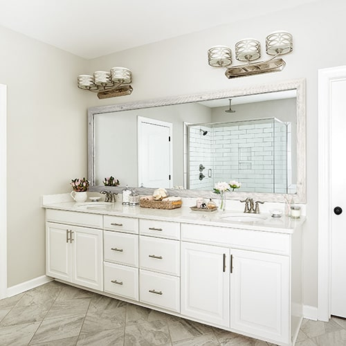 Cherokee French White Oak mirror frame situated above the vanity.