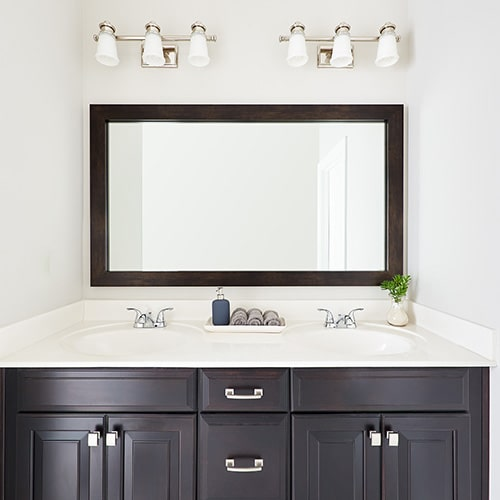 Cherokee Espresso Walnut mirror frame situated above the vanity.